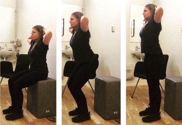 Nina utför standups med psoaskudde